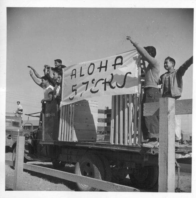 Residents of block 57, at the Tule Lake Center, wave farewell to friends entraining for other centers. -- Photographer: Mace, Charles E. -- Newell, California. 9/?/43. Source.