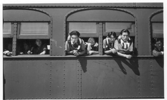 A group of Hawaiian evacuees waiting for the segregation train to start. -- Photographer: Lynn, Charles R. -- Dermott, Arkansas. 9/19/43. Source.