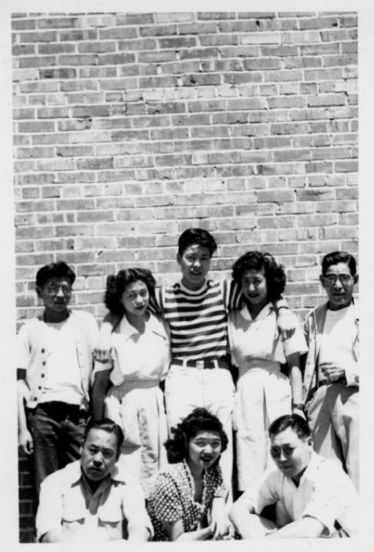Hospital staff[?] in front of wall at Tule Lake Relocation Center. 1941/1945. Source.