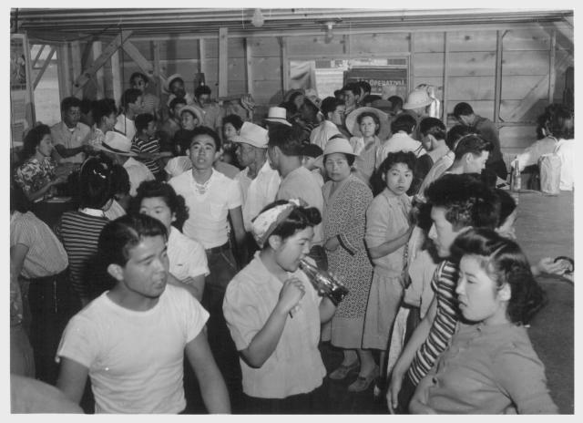 Tule Lake--Newell, Calif.--A view showing part of the crowd at general store no. 1 at this War Relocation Authority center where evacuees of Japanese descent are spending the duration. -- Photographer: Stewart, Francis -- Newell, California. 7/1/42. Source.