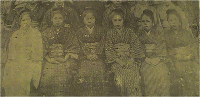 """Early twentieth century photos of Okinawan school girls wearing Ryukyuan clothes [top] versus Japanese clothes [bottom], both photos were taken on the same day to show how the girls were required to change their dress in the early twentieth century. Source: Hokama Yoneko, Jidai o irodotta onnatachi: Kindai Okinawa joseishi, Naha: Niraisha, 1996, p. 210."" -Barske"