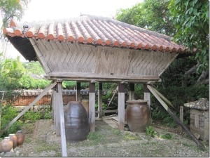 Across the Nakasone house in the Ryukyu Mura cultural village is an elevated storehouse, like the one my Dad sketched and the one found in Kerr's book.