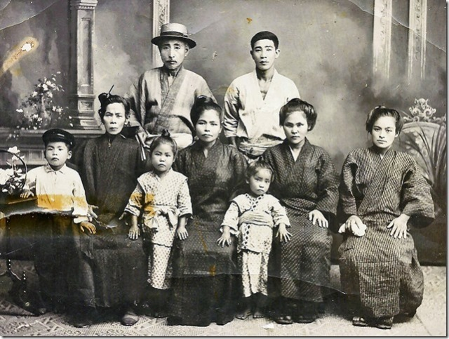 picture is the Okinawa Inafuku family taken just before my grandmother left Okinawa in 1912 for Hawaii to be with my grandfather.  In the picture below, she is sitting between the two gentlemen standing.  The young gentleman standing is my grandfather's younger brother, Uncle Hoso.  Uncle Hoso's wife Kama is the young lady on the right.  The gentleman with the hat is my great-grandfather.
