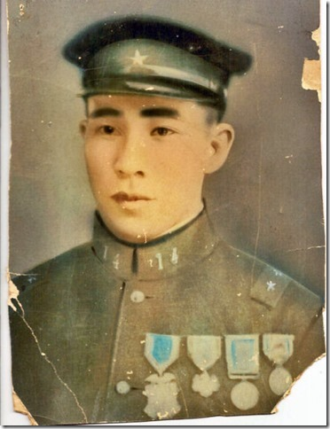 "A photo of Uncle Hoso Inafuku with his medals.  My Dad said that uncle Hoso could not bend his knees... which I believe got broken during the war.  When he returned from the war, he was known as ""stiff legs"" in the village."