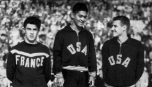Standing on the podium at the Helinski Olympics in 1952.