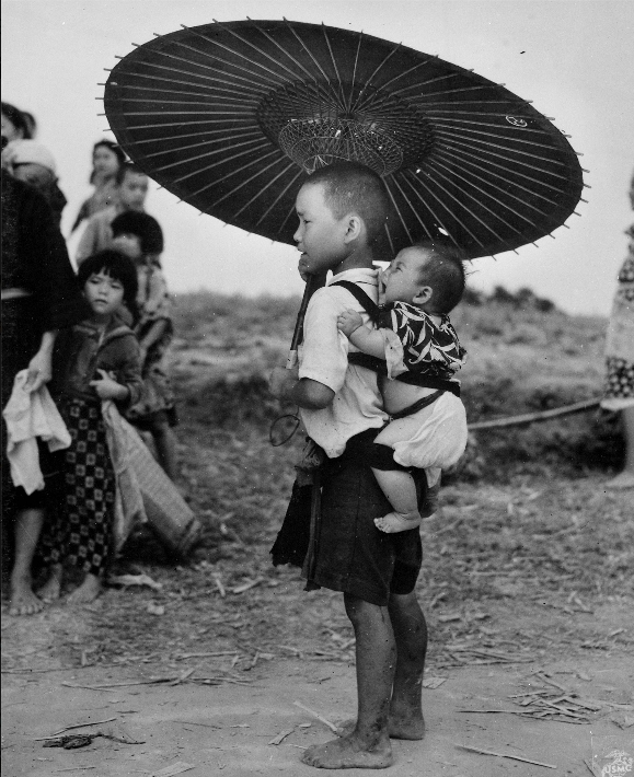 Children stand on the road during the Battle of Okinawa. Wikimedia Commons/National Archives and Record.