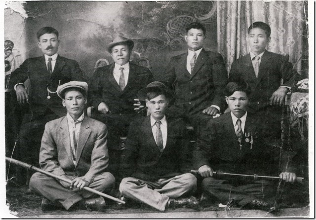 Hoichi and and his dad Hoyei Inafuku among a group of Okinawan men.  Hoichi is the young man in the middle sitting on the floor.  His father Hoyei, my grandfather, is sitting on the chair with his left arm on the table... the one without the mustache.