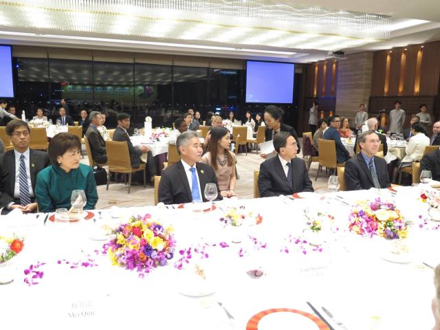 Photo of Governor Ige and First Lady with Guangdong Governor Zhu Xiaodan and American Consulate General Charles Bennett at the White Swan Hotel. 40 member delegation attended the gala reception hosted by Guangdong Province which featured entertainers from Hawaii and Guangdong.
